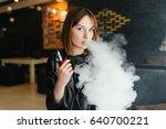 modern girl smoking vape.trendy ...   Shutterstock . vector #640700221