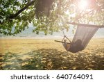 beach cradle under the tree by... | Shutterstock . vector #640764091