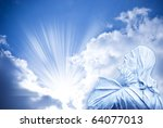 Jesus Christ in praying gesture over mystical sky with divine rays of light - stock photo