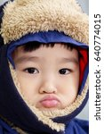close up on face of asian child ... | Shutterstock . vector #640774015