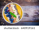 mango smoothies bowl with... | Shutterstock . vector #640919161
