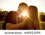 kiss of a loving couple at... | Shutterstock . vector #640921099