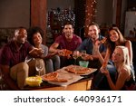 young adults eating pizza at a... | Shutterstock . vector #640936171