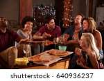 young adults sharing pizzas at... | Shutterstock . vector #640936237
