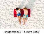 top view of couple lying on... | Shutterstock . vector #640956859