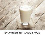 big glass of milk with napkin... | Shutterstock . vector #640957921