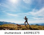 man runs with his beagle dog on ... | Shutterstock . vector #640981375