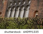 Old brick facade with arch windows - stock photo