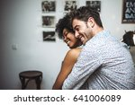 man embracing woman from back... | Shutterstock . vector #641006089