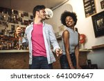 young couple dancing lively in... | Shutterstock . vector #641009647