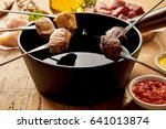 Skewered Meat Chunks And Pot Of ...