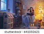 family reading bedtime. pretty...   Shutterstock . vector #641032621