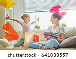 Stock photo beautiful young woman and child girl little helper are having fun and smiling while doing laundry 641033557