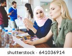 female coworkers among business ... | Shutterstock . vector #641036914