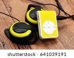 Small photo of Yellow music player and beautiful overhead headphones, lux