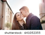 a boyfriend whispering into his ... | Shutterstock . vector #641052355