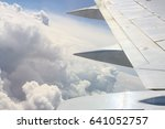 wing of the plane on blue sky... | Shutterstock . vector #641052757