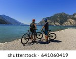 mountain biking  couple with... | Shutterstock . vector #641060419