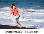 Kid Runs On The Beach
