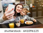 a young mother makes selfie... | Shutterstock . vector #641096125