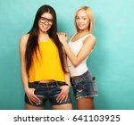 two young girl friends standing ... | Shutterstock . vector #641103925