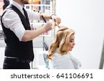male hairdresser does a... | Shutterstock . vector #641106691