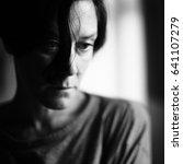 closeup portrait of a sad woman | Shutterstock . vector #641107279