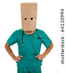 male doctor with paper bag on his head - stock photo