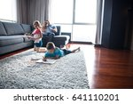 happy young family playing... | Shutterstock . vector #641110201
