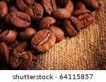 Coffee beans in canvas sack - stock photo