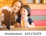 asian mother and daughter using ... | Shutterstock . vector #641176255