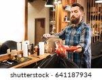 serious experienced hairdresser ... | Shutterstock . vector #641187934