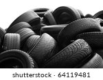 Heap Of Worn Out Tires On Whit...