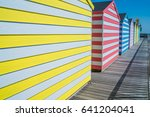 colorful wooden huts on... | Shutterstock . vector #641204041