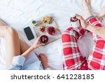 couple having breakfast in bed. ... | Shutterstock . vector #641228185