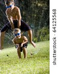 Small photo of Children having fun getting wet and playing leapfrog, ages 7 and 9