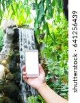 a man holding a smart phone... | Shutterstock . vector #641256439