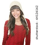 Beautiful winter woman portrait. Asian happy girl posing with winter sweater and knit hat on white background. - stock photo