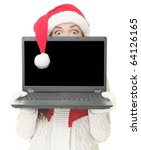 Christmas internet shopping. Woman in santa hat shocked holding computer with blank screen for advertising message - stock photo