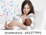 mother with sleeping baby... | Shutterstock . vector #641277991