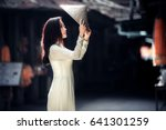 young beautiful woman in ao dai ... | Shutterstock . vector #641301259