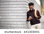 african american man using phone | Shutterstock . vector #641303041