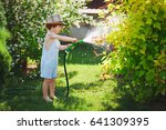 cute little boy watering the... | Shutterstock . vector #641309395