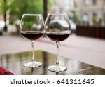 Two Glasses With Red Wine In A...
