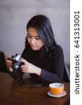 asian woman holding vintage...   Shutterstock . vector #641313001