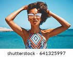 outdoor fashion photo of... | Shutterstock . vector #641325997