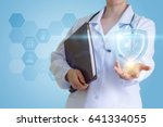 the doctor supports a symbol of ... | Shutterstock . vector #641334055