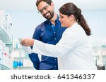 pharmacist talking to customer... | Shutterstock . vector #641346337