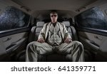 man in a white suit with a gun  ... | Shutterstock . vector #641359771