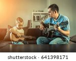 father teaching his son to play ... | Shutterstock . vector #641398171